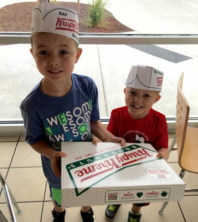 Kids with Krispy Kremes